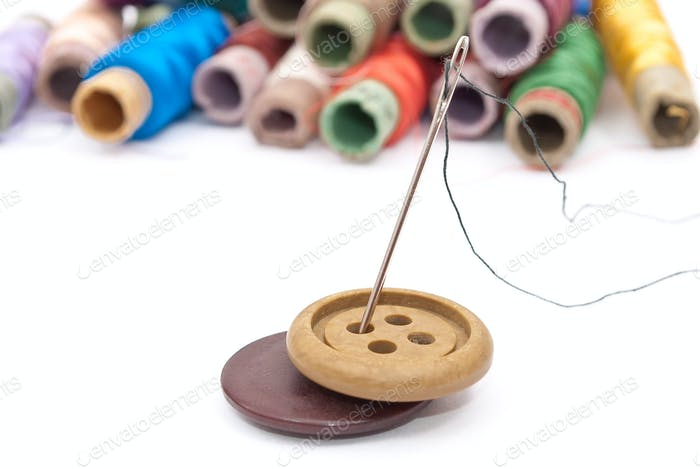 Buttons and threads with a needle