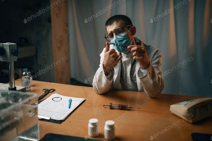 Psychiatrist in mask and glasses, mental hospital