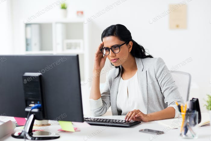 stressed businesswoman with computer at office