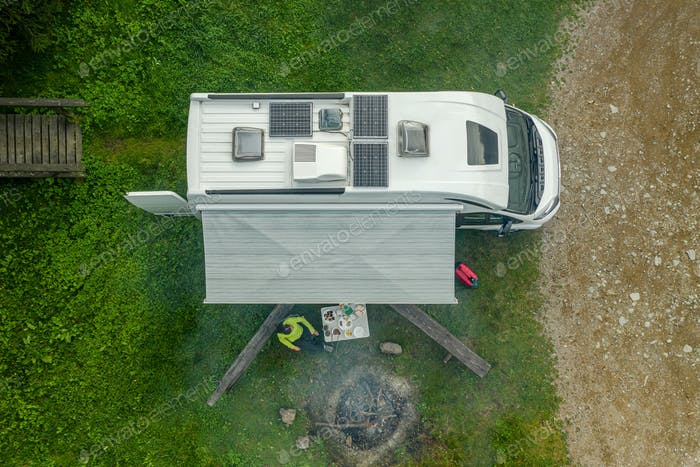 RV Park Pitch with Camper Van and Campfire Place Aerial View