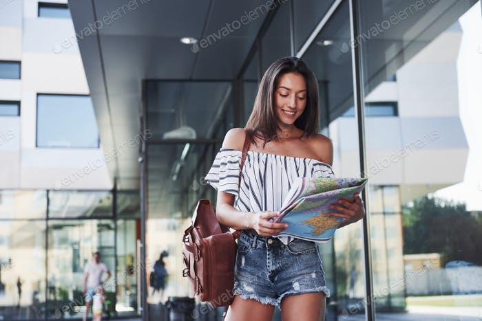 The girl is traveling with a backpack to the cities of Europe