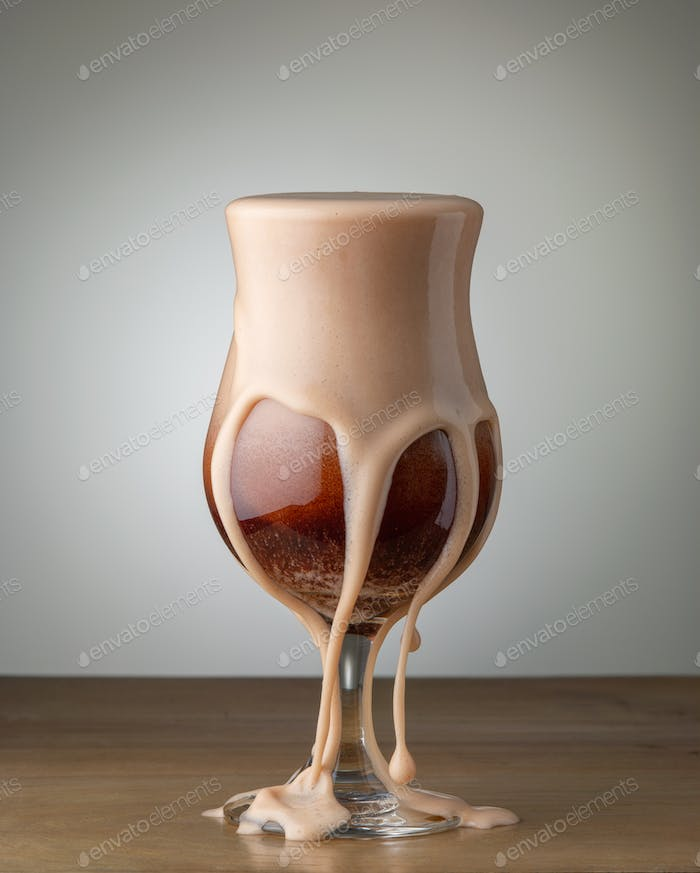 glass of beer cocktail with splashes