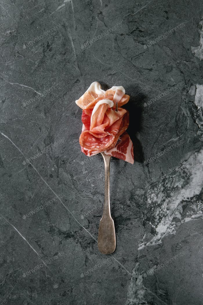 Meat assorti on fork