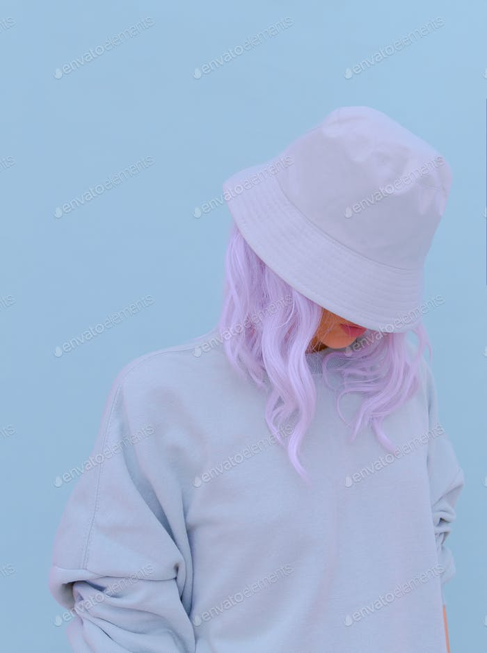 Aesthetic blonde girl in stylish accessories panama hat. Fresh blue monochrome colours trend