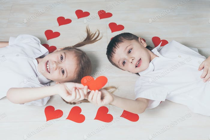 little boy and girl lying on the floor.