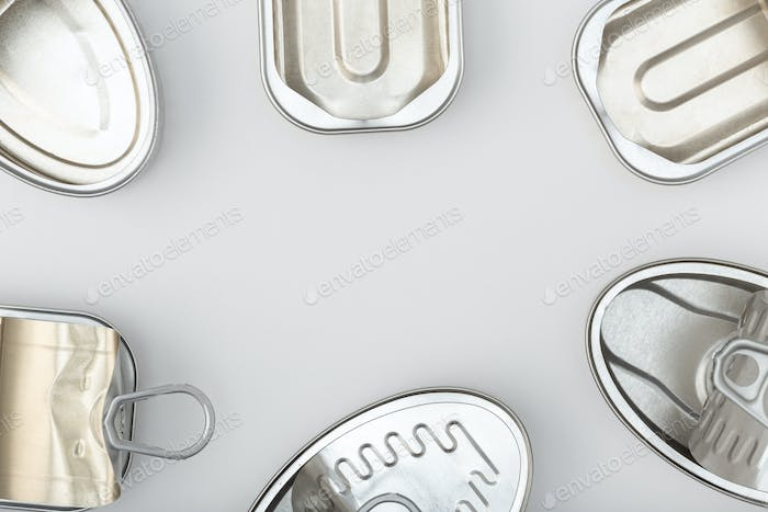 Group of empty tin can isolated on a gray background