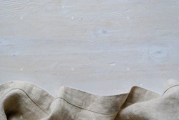 Linen fabric border over painted white wood