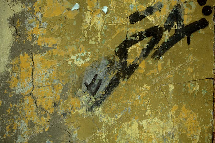 Abstract black graffiti on an old grunge wall