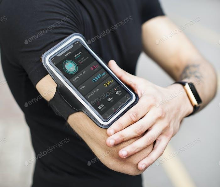A man wearing a smartphone armband