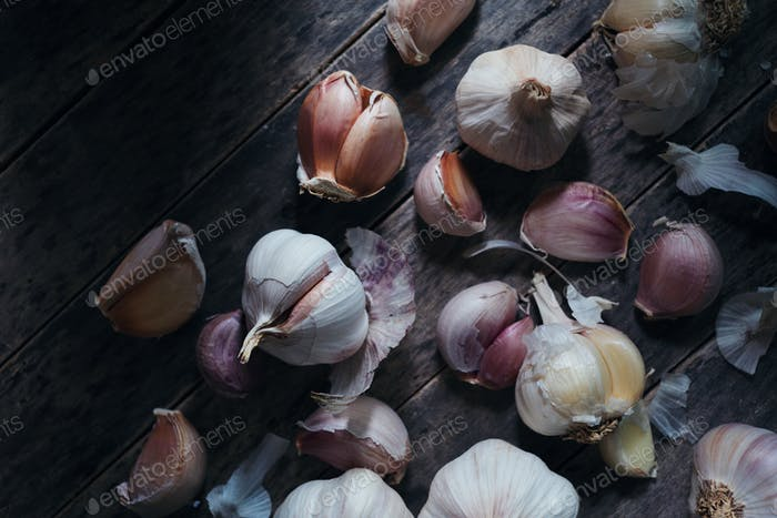 Garlic bulb and clove on rustic wooden