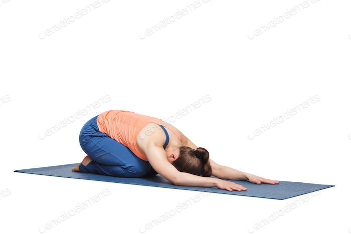 Beautiful sporty fit yogi girl practices yoga asana balasana