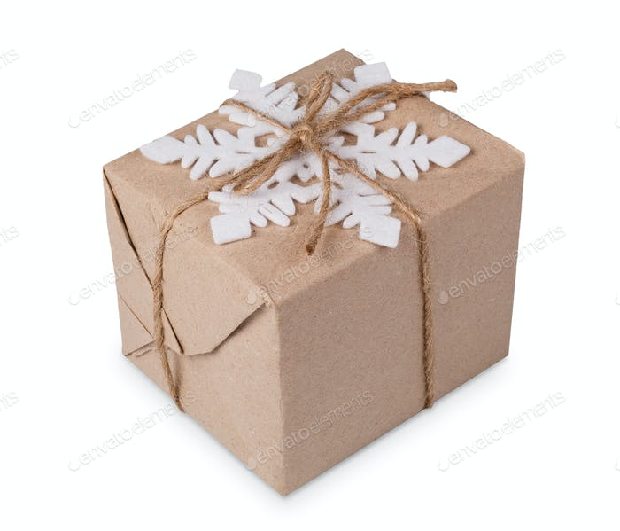 Christmas gift box in craft paper isolated on white
