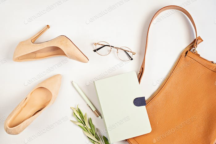 Flat lay with woman fashion accessories in neutral colors. Beauty blog, style, trends