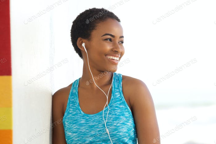 smiling exercise woman listening to music with earphones