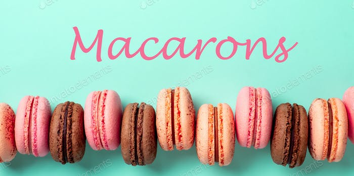Letters macarons and row of macarons on turquoise
