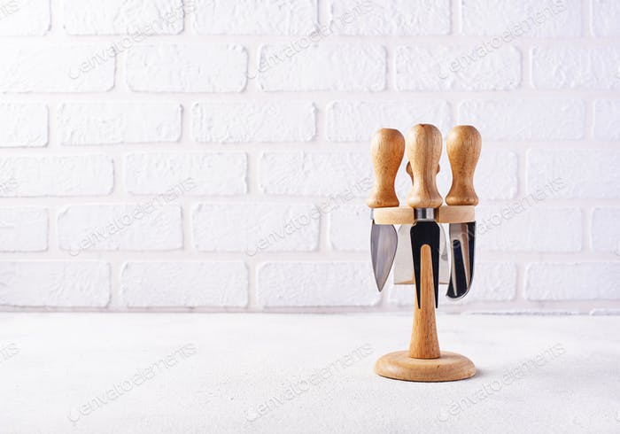 Cheese knives on white background
