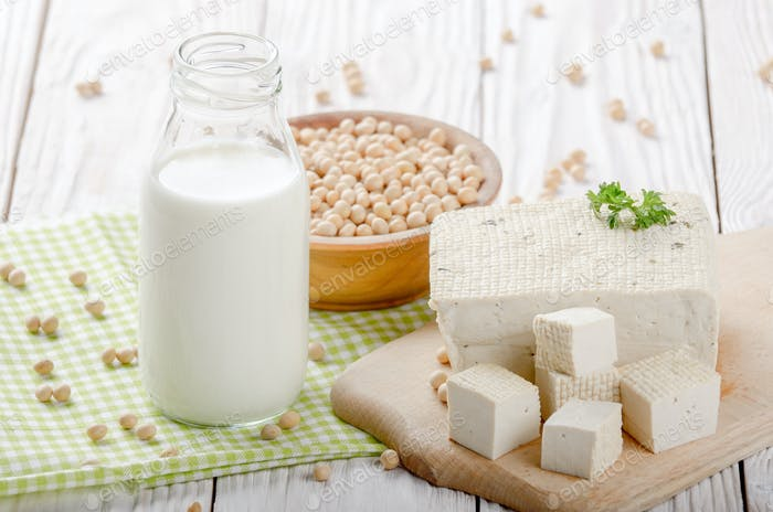 Non-dairy alternatives Soy milk or yogurt in glass bottle and to