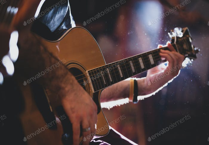 Playing classic guitar. Selective focus.