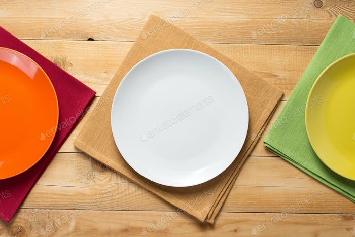 plate and napkin cloth at rustic wooden table background