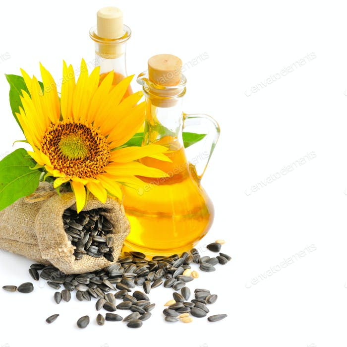 Sunflower seeds on a background of small bag with flower and a b