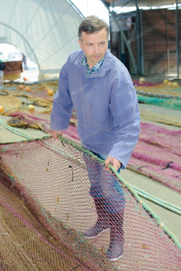Man sraightening fishing net