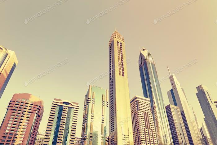 Looking up at Dubai skyscrapers skyline.