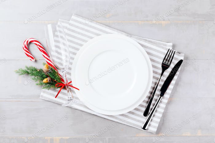 Christmas Setting Table with Champagne Glass on Grey Background.