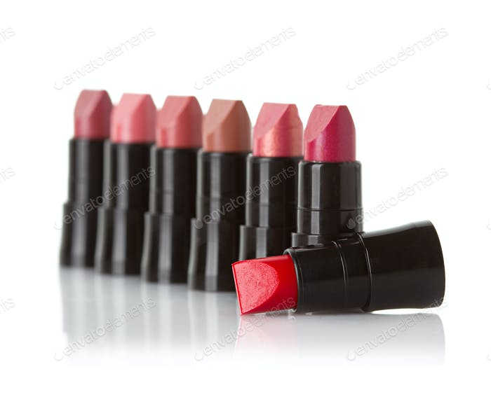 Beautiful lipsticks isolated on white