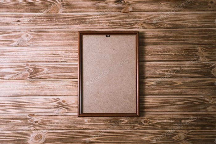 vintage photo frame on wooden board background texture
