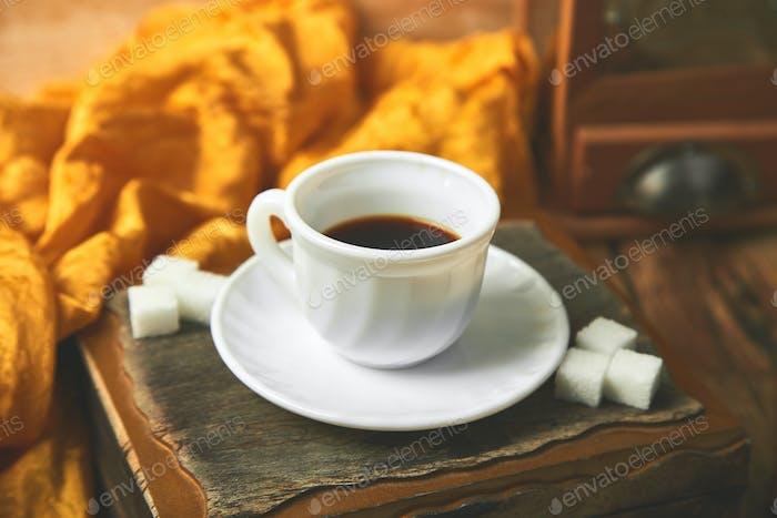One cup  of coffee espresso near sugar cube