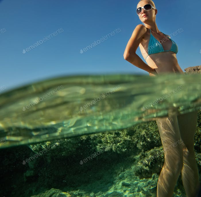 Attractive woman standing in the water