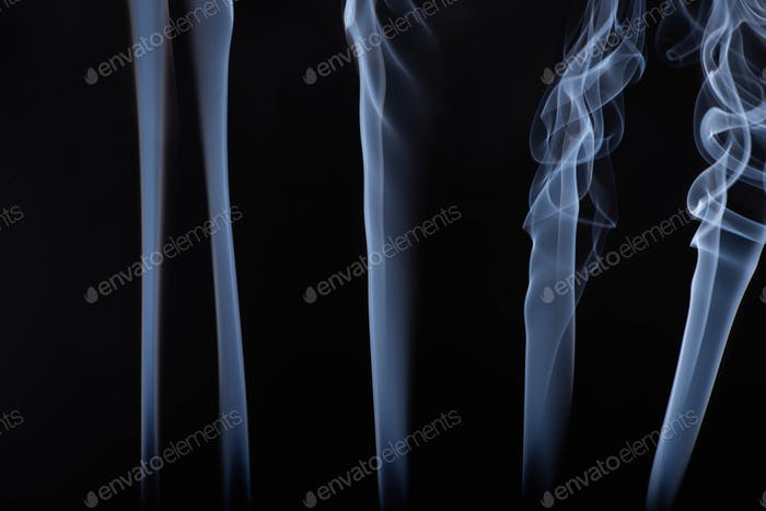 White Flowing Smoke Steams on Black Background
