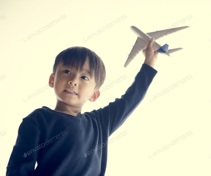 Japanese boy playing with his toy plane