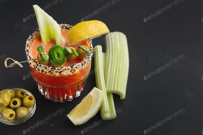 Bloody Mary cocktail with green olive, lettuce and lemon