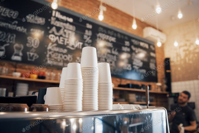 Hipster looking coffee shop ready to open for the day with a clean and tidy counter