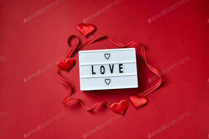 Love lightbox message with red hearts on red background