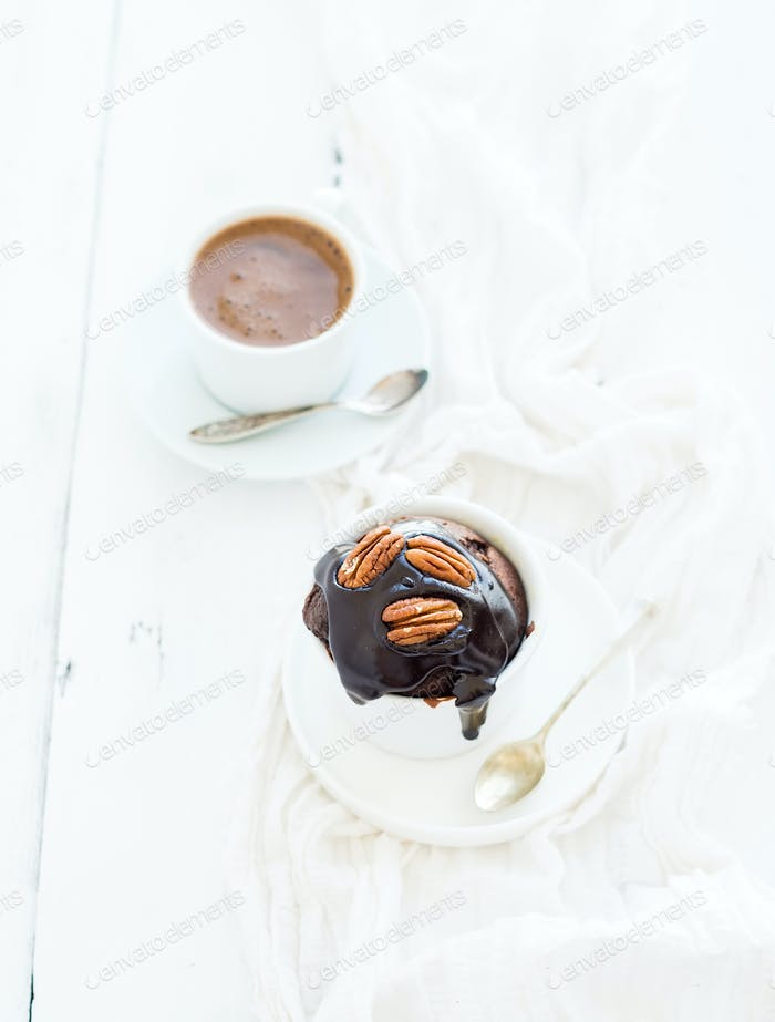 Tasty homemade brown muffin with chocolate ganache icing