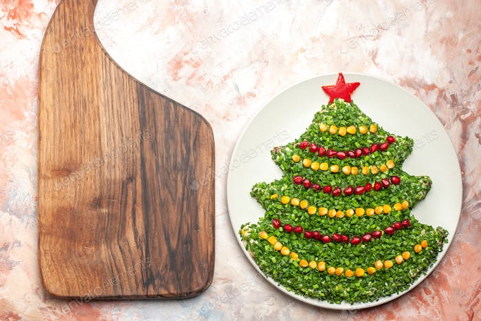 top view tasty green salad in new year tree shape inside plate on light background meal photo xmas