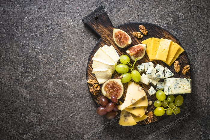 Cheese plate with grapes, figs and nuts