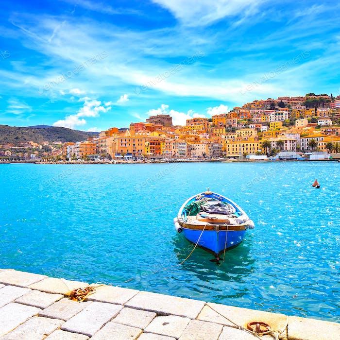 Wooden small boat in Porto Santo Stefano seafront. Argentario, T