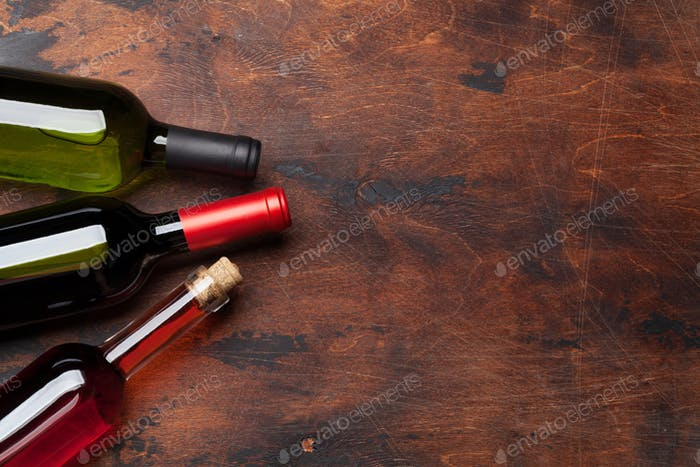 Various wine bottles on wooden table