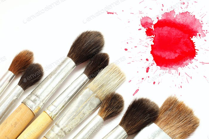 Set of brushes and red blot