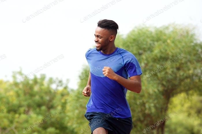 young black man enjoying his run outside