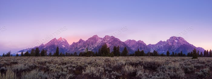 Panoramic view of colorful sunrise at Grand Teton, USA