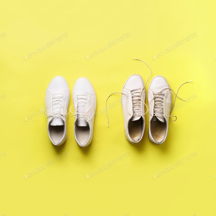 Old dirty sneakers vs new white sneakers on yellow background. Trendy footwear. Square crop. Top