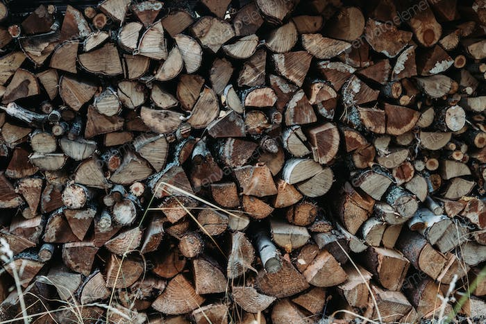 A large stack of firewood for the winter at outdoor