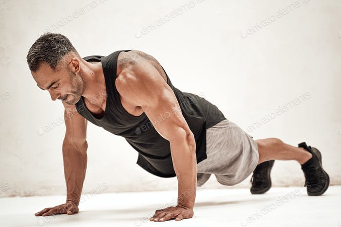 Embossed fitness couch doing a plank exercise looking powerful