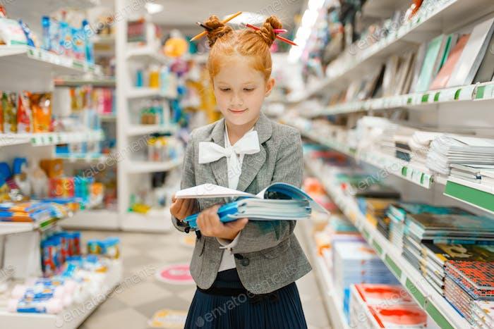 Little school girl in stationery store