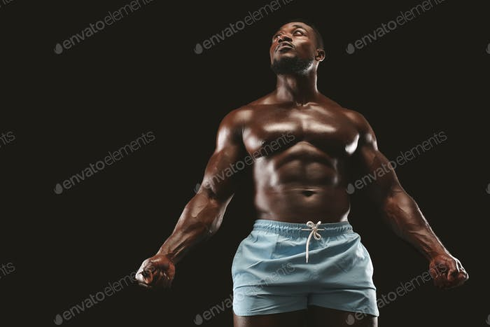 Hot african american guy demonstrating naked muscular body