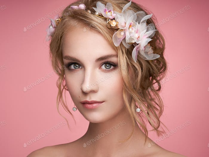 Young blonde woman with tiara on her head